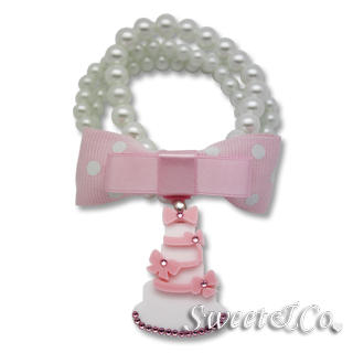 Sweet & Co. - Sweet Pink polka dots bow dolly cake charm pearly bracelet